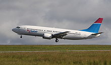 photo FlySafair_B737-4Y0_ZS-JRE_(Flying_for_Mango)_(13196984215)